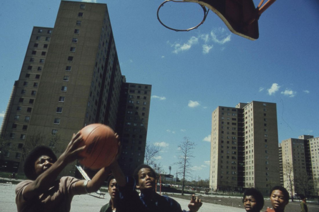 Black youths play basketball at Stateway Gardens' highrise housing project on Chicago's South Side.