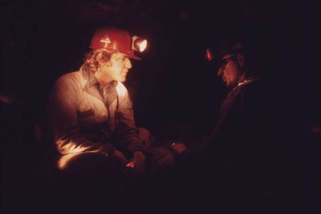 Veteran Miner Harold Stanley (right), talks to a young miner who has come into the mine for the first time after 40 hours of classroom training, April 1974